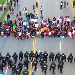 Tense Protest Turns Emotional as 60 North Carolina Police Kneel Before Demonstrators