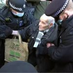 Crowd Shames Police as 92-Year-Old Man Is Arrested at Assange Bail Hearing